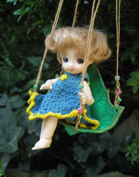 Brownie doll with a swing with knotted jute & bead cords