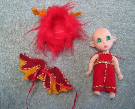 Philia's costume was hand-sewn. The wings and overalls were made of wool felt.