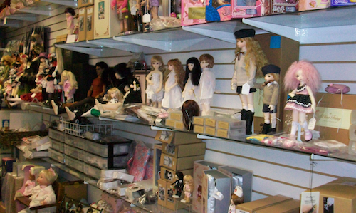 Dolls on display including Blue Fairy