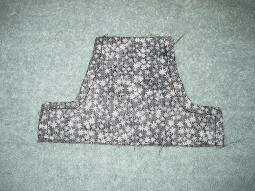 Halter with only sides sewn together.  Lace will be added to the bottom.
