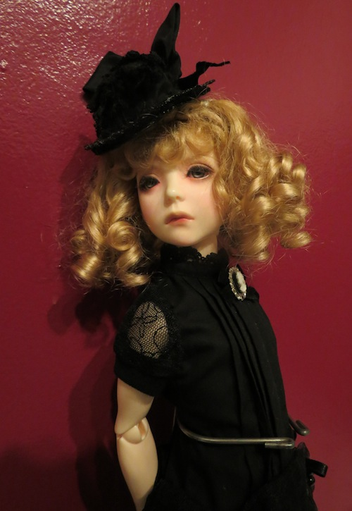 Alix in an antique doll hat and a Dollmore dress